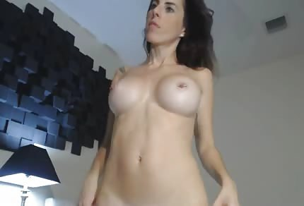Brunette chick puts dildo in her ass