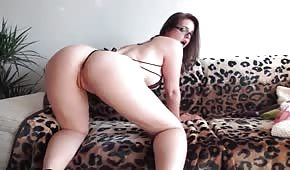 Sexy brunette is playing with her pussy