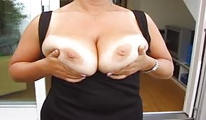 Sexy mommy is showing her big tits