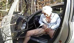 Mature mommy is masturbating in the forest