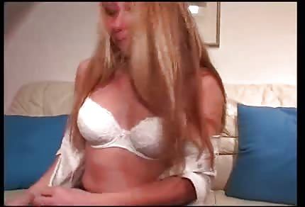 Blonde babe is playing with her tight pussy
