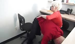 Mature blonde woman in the office