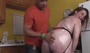 He's fucking a chubby lady in the kitchen